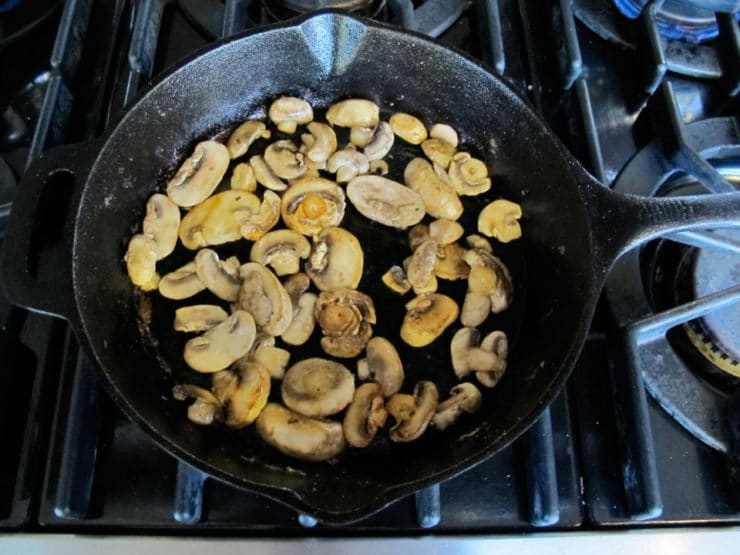 Sliced mushrooms in a skillet.