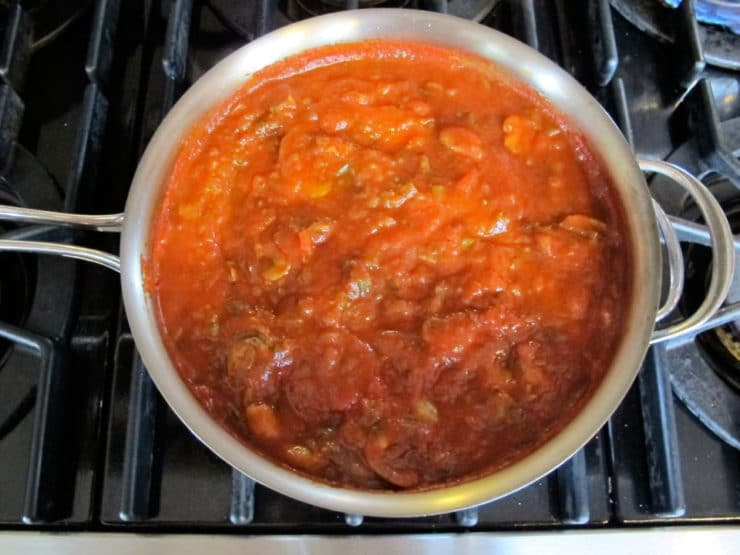 Mushrooms added to tomato sauce.