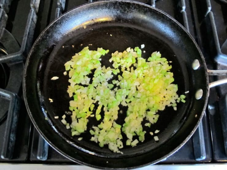 Minced celery and onion in a skillet.