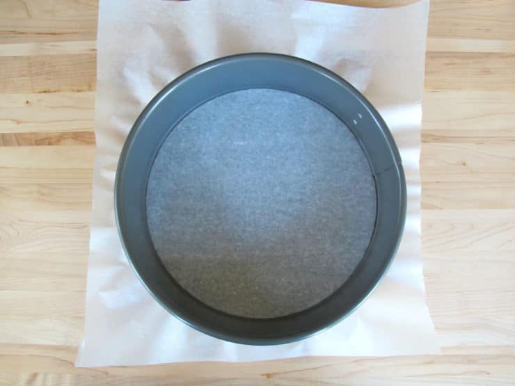 Line a springform pan with parchment paper.