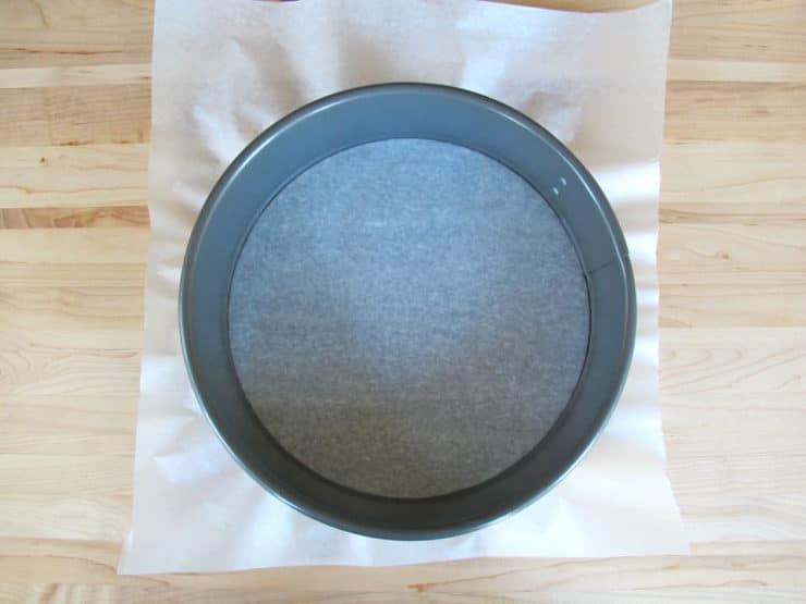 Line a springform pan with parchment paper.