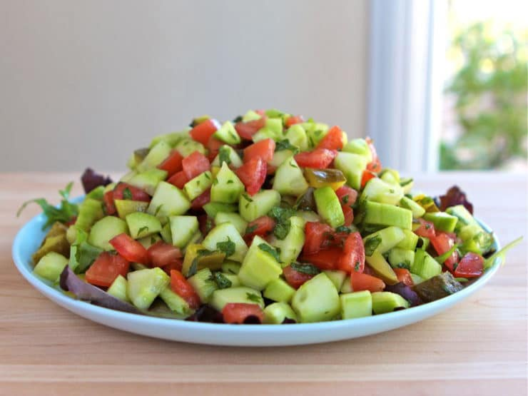 Israeli Salad with Pickles and Mint - Learn the history of Israeli salad and try my recipe, inspired by News Cafe Miami. Kosher, Vegan, Gluten Free, Healthy.