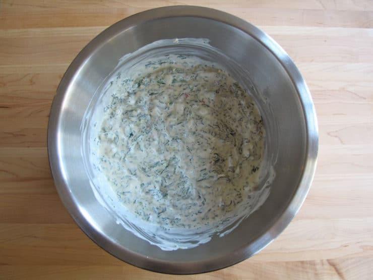 Spinach stirred into sour cream.