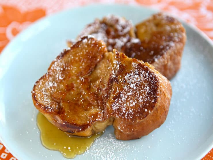Challah French Toast - Learn to make fluffy restaurant-quality Challah French Toast with milk, banana, cinnamon, vanilla, sugar, & optional liqueur. Kosher, Dairy.