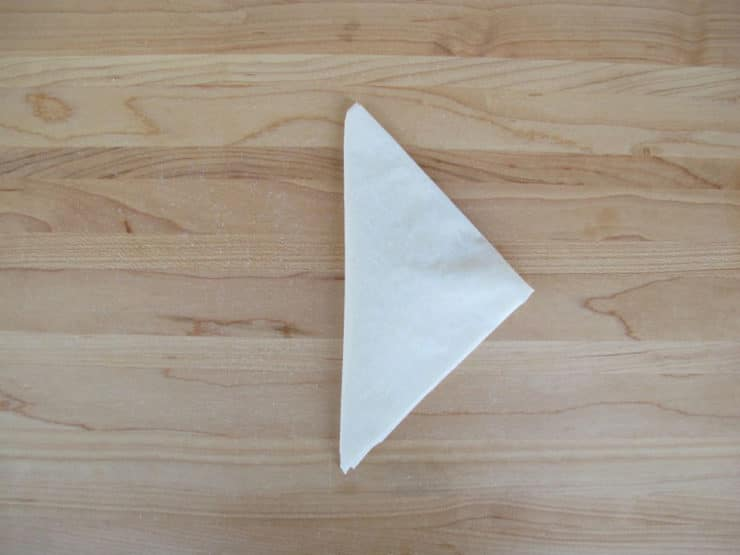 Folded into a neat triangle.