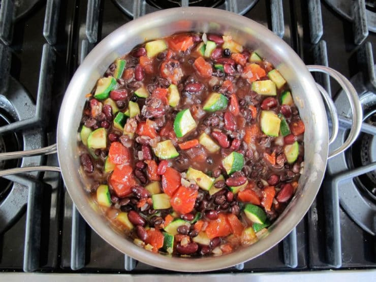 Vegetables added to skillet to saute.