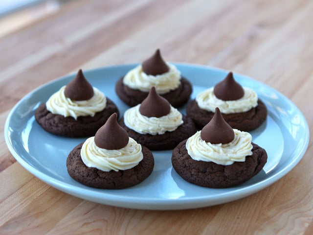 Hershey's Chocolate Kiss Cakelets - The history of Hershey Chocolate Company, Milton Hershey, and a recipe for soft cake-like cookies with vanilla buttercream frosting and chocolate kisses. Kosher, Dairy.