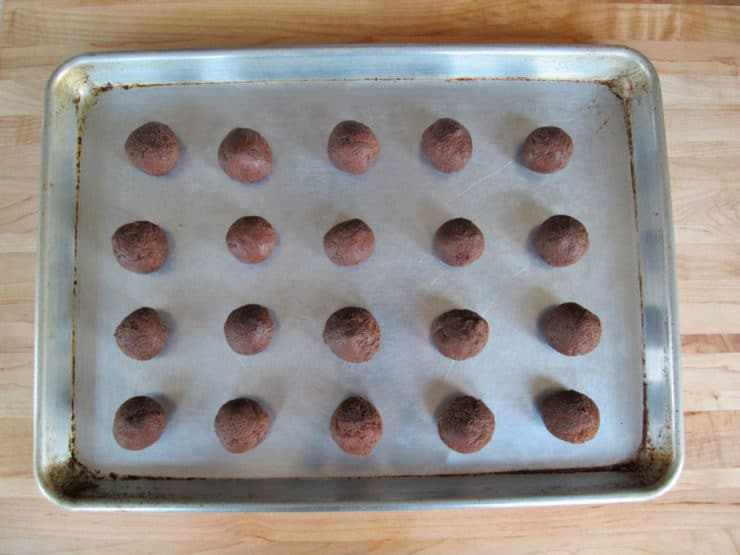 Rolled cookie dough on a baking sheet.