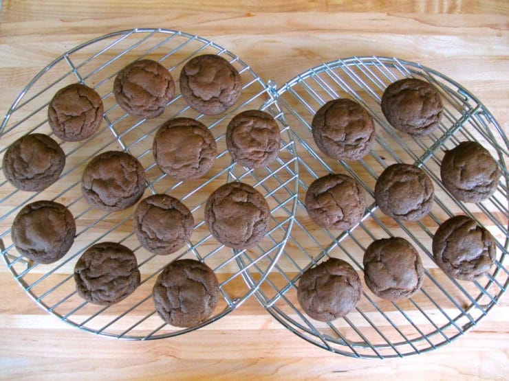 Mini cakes cooling on a rack.