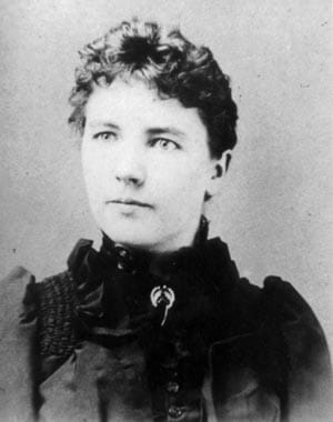 Black and white photograph of Laura Ingalls Wilder in a black dress.
