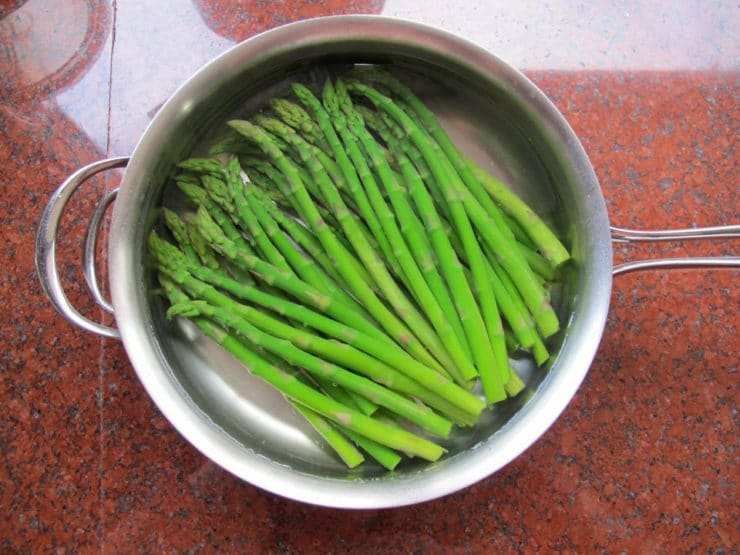 Asparagus in cold water to blanch.