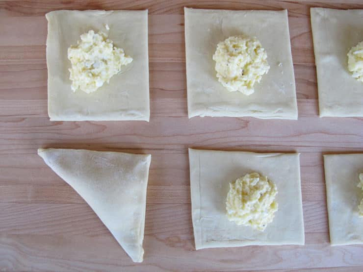 Fold dough into triangle over filling.