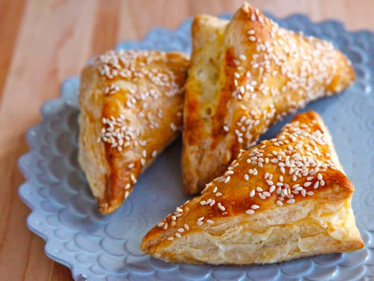 How to Make Bourekas with Puff Pastry - Learn to make bourekas using puff pastry and any of your favorite fillings with this step-by-step recipe. Bureka, boreka, borek, savory hand pies.