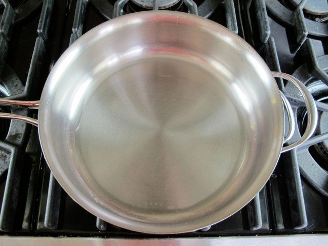 Skillet heating up on stovetop.