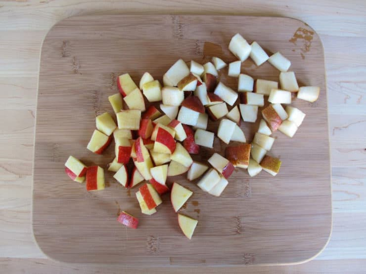 Chopped apple and pear on a cutting board.