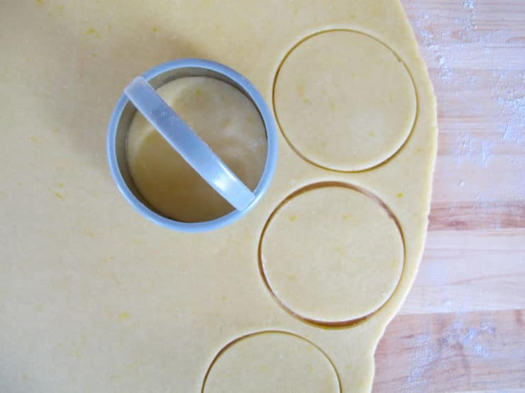 Cutting dough circles out.