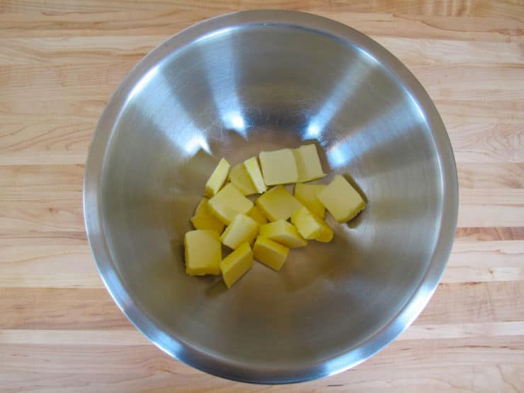 Sliced butter in a mixing bowl.