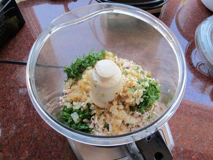 Chicken and seasoning in a food processor.