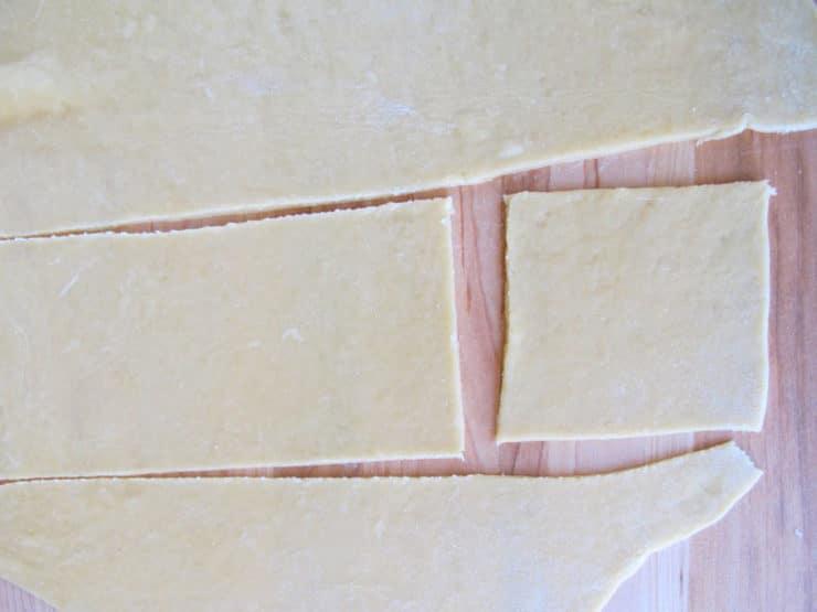Dough cut in squares.