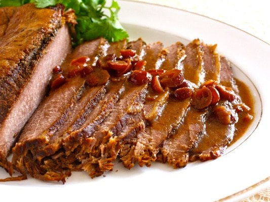 Slow Cooker Brisket with Chipotle Cranberry Sauce - Learn to make a slow cooker brisket for Passover inspired by Mexican flavors from Cheryl Lee - chipotle peppers for smoky heat & dried cranberries for sweetness.