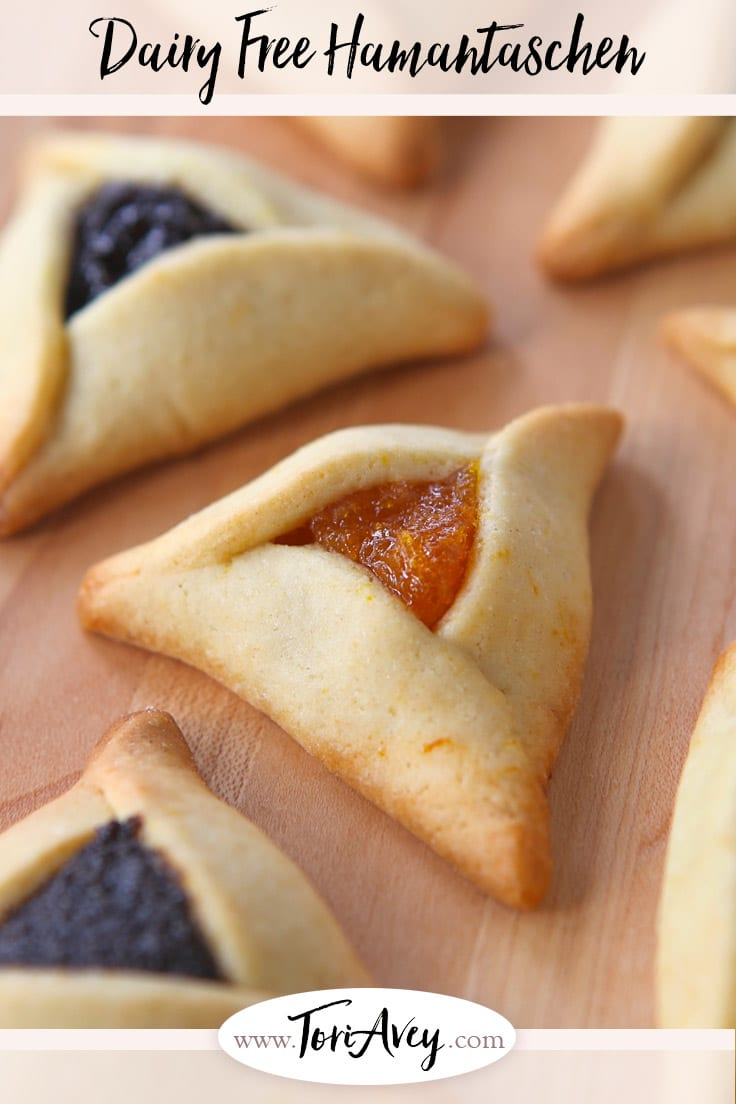 Dairy Free Hamantaschen - Learn to make pareve hamantaschen dough, easy to work with for any filling. Delicate, thin, orange-scented cookies. | ToriAvey.com #cookies #dairyfree #kosher #parve #hamantaschen #holidaycookies #purim #cookiefilling #hamanshats #howto #kitchentips #purimcookies #cookieartistry #nomnom #dessert #baking #bakingproject #bakethis #todayIlearned #holidayproject #jewishholidays