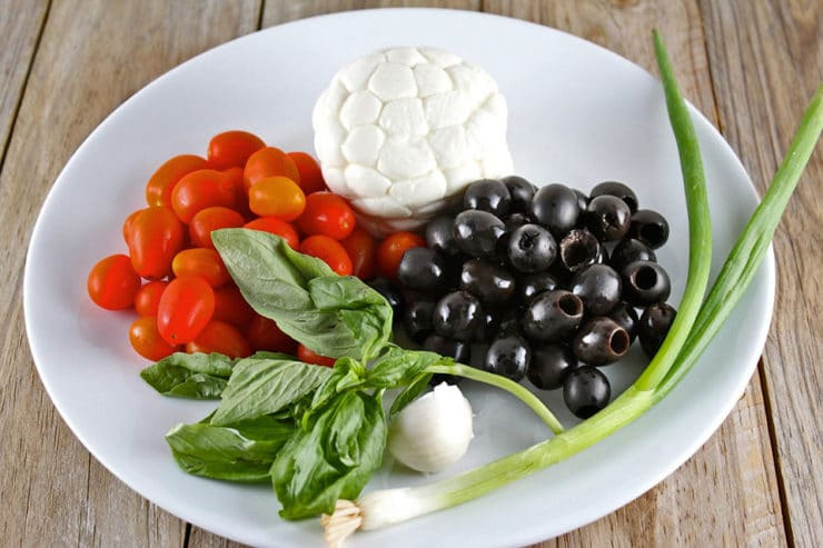 Caprese ingredients in a large bowl.