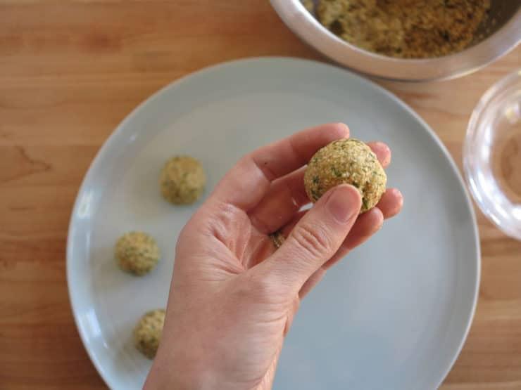 Rolling matzo balls.
