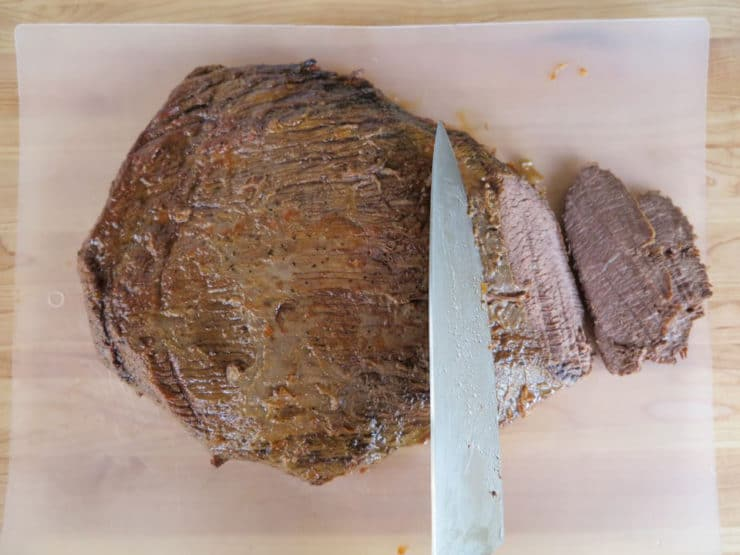 Slicing brisket against the grain.