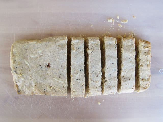 Slicing loaves into biscotti shape.