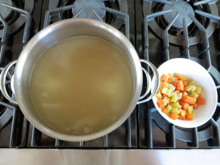 Vegetables pulled from pot of stock.