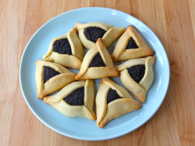 How to Make Perfect Hamantaschen - Learn to make perfectly shaped hamantaschen that won't open, spread, or leak in the oven. Tips, recipes, folding techniques, troubleshooting.