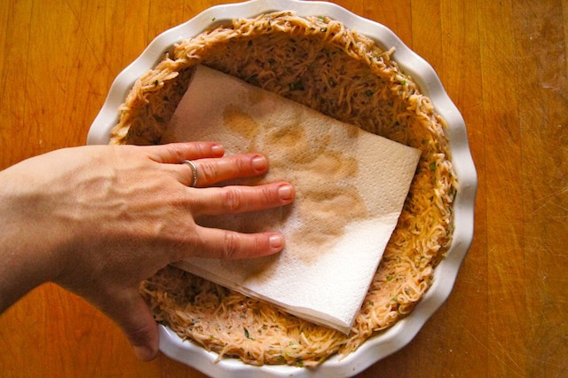 Blotting potato crust with paper towel.