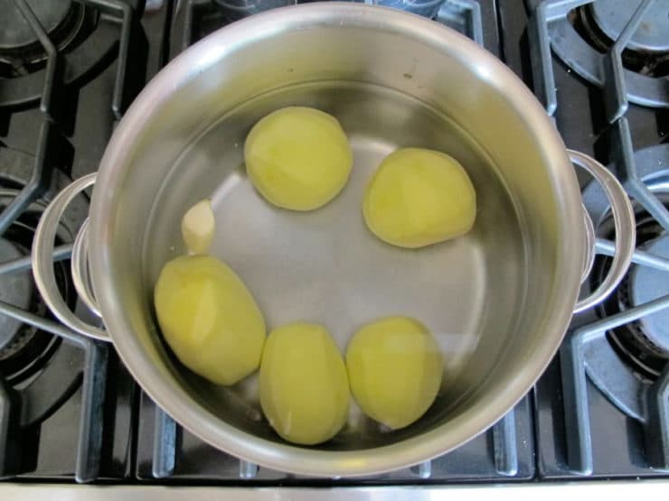 Peeled potatoes in boiling water.