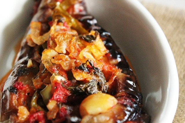Turkish Imam Bayildi - Imam Fainted. Roasted eggplant stuffed with onions, garlic and peppers in sauce from Ilke of Ilke's Kitchen. Pareve, Vegan, Kosher for Passover.