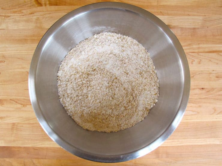 Oats and flour in a mixing bowl.