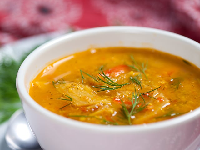 Fish Soup - Learn an exotic, colorful recipe for kosher fish soup from Levana Kirschenbaum. Pareve, Kosher for Passover.