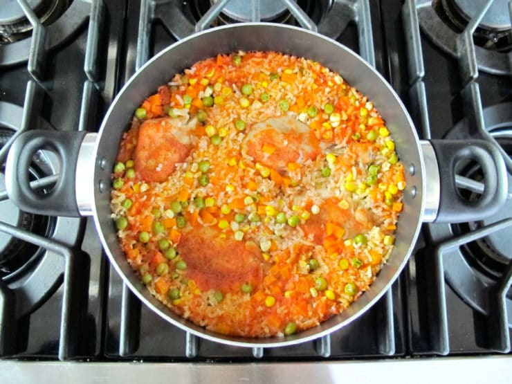 Arroz con Pollo in a skillet.