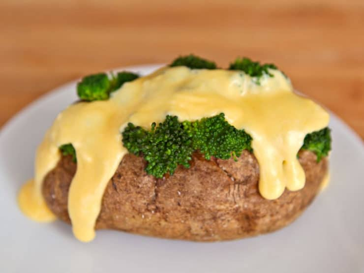 Broccoli Cheese Potatoes - Baked potatoes with broccoli and creamy melty homemade cheddar cheese sauce. Vegetarian meal, comfort food. Simple gluten free modification.