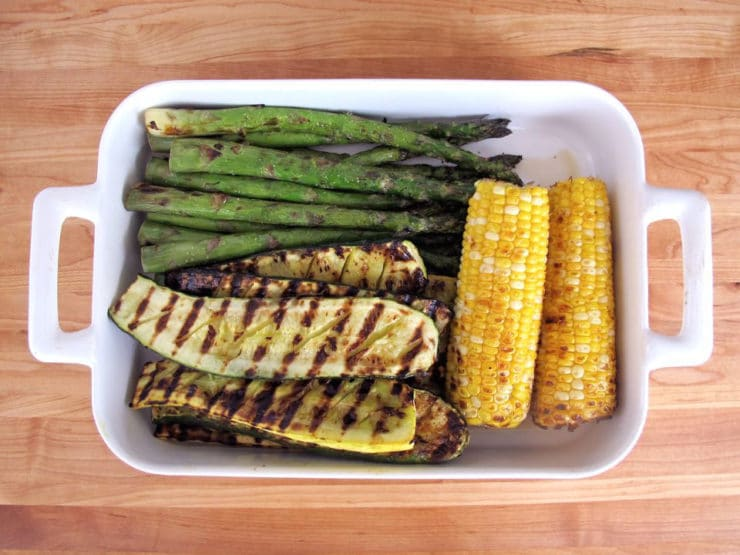 Grilled vegetables resting in a dish.