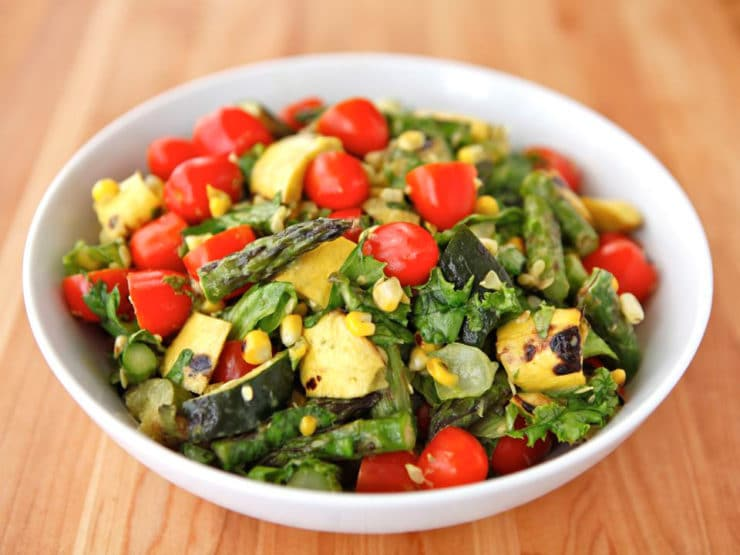 Grilled Vegetable Salad - Grilled zucchini, squash, asparagus, corn, tomatoes, lettuce & basil with lemony basil dressing. Gluten Free, Vegetarian, Vegan with Sub, Pareve