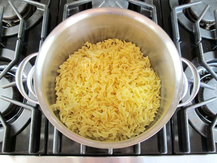 Cooked noodles in a stockpot.