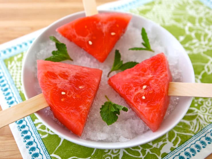 Watermelon Mojito Pops - slices of watermelon soaked in a mojito cocktail mixture, then frozen. A simple grown up boozy summer popsicle!