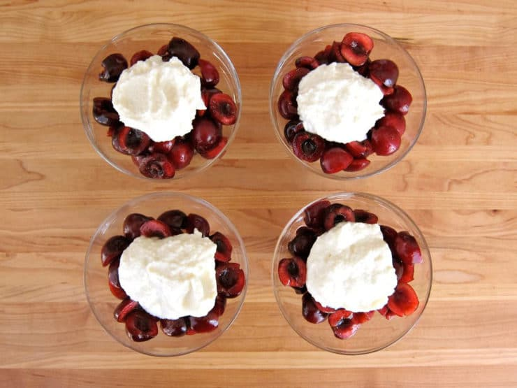 Cherries and cheese in 4 small dishes.