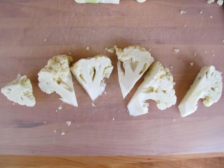 Cutting cauliflower into florets.