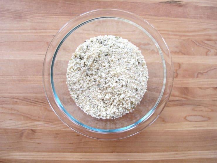 Seasoned breadcrumbs in a small bowl.