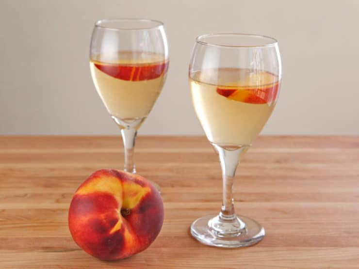Peach Sangria -  Learn to make white sangria with peaches, the perfect cold refreshing party drink for summer.