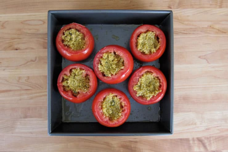Cored tomatoes stuffed with quinoa.