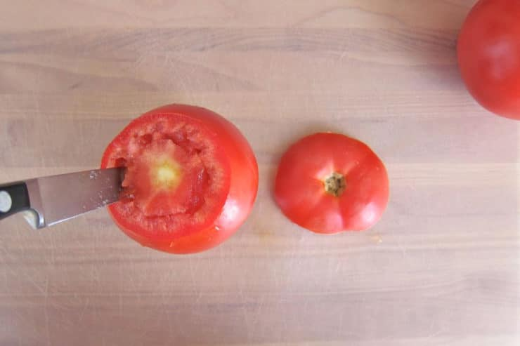 Coring flesh from tomatoes.