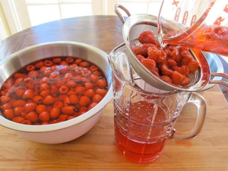 Straining raspberry cordial.