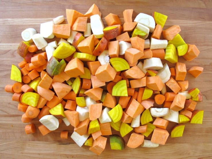 Diced root vegetables on a cutting board.